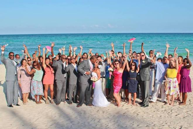Everyone at the wedding shows off big smiles for the camera!