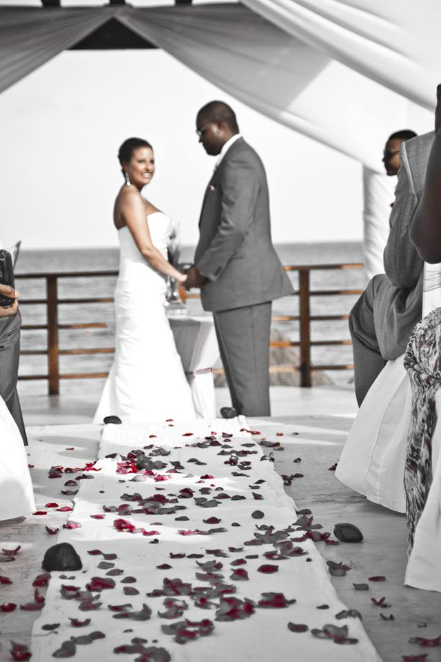 Mr. & Mrs. Dunn chose a beautiful color scheme of silver and pink for their beach wedding. The rose petals are a nice touch!