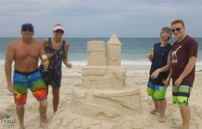 Standing much taller than their first creation, the family's second sand castle is a veritable feat of creative—and architectural--genius.
