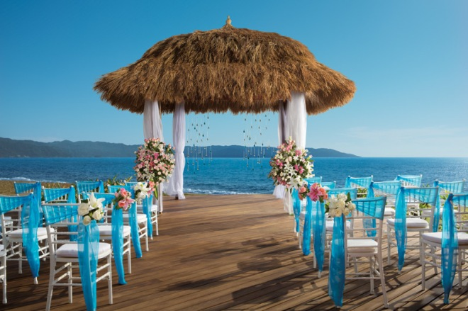 The gorgeous thatched wedding gazebo overlooking the ocean in Now Amber!