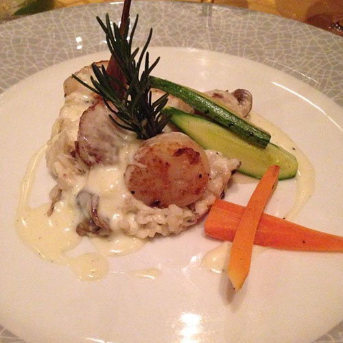 My meal at Capers Italian Restaurant: Grilled scallops over a bed of mushroom risotto with a vanilla cream sauce (YUM!)