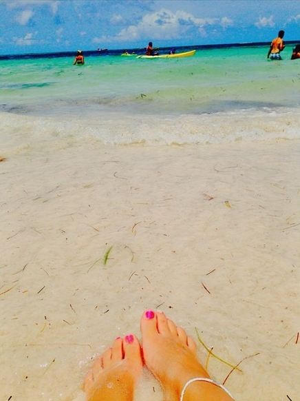 Meghan G. dips her toes in the crystal blue waters at Now Larimar Punta Cana!